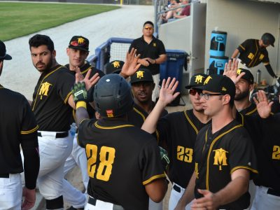 Miners Celebrate Win Over Dominican Republic